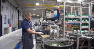 Versamatic Employee Preparing an AODD Pump for Use